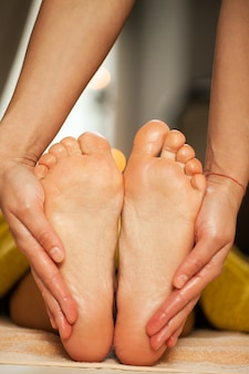Foot massage for a woman in a spa