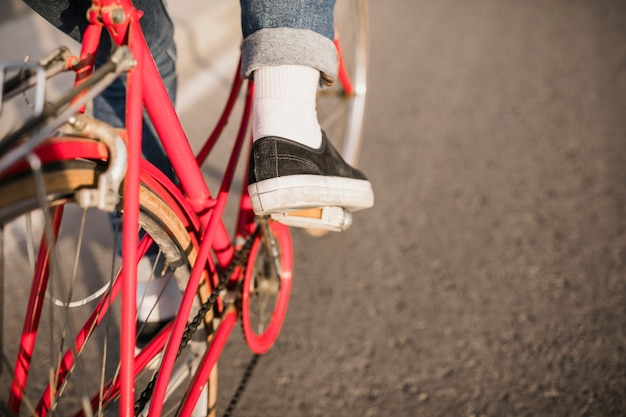 Foot on pedal of bicycle
