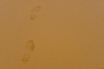 Foot print on sand background