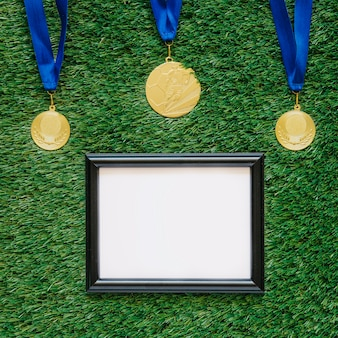 Football background with frame below medals