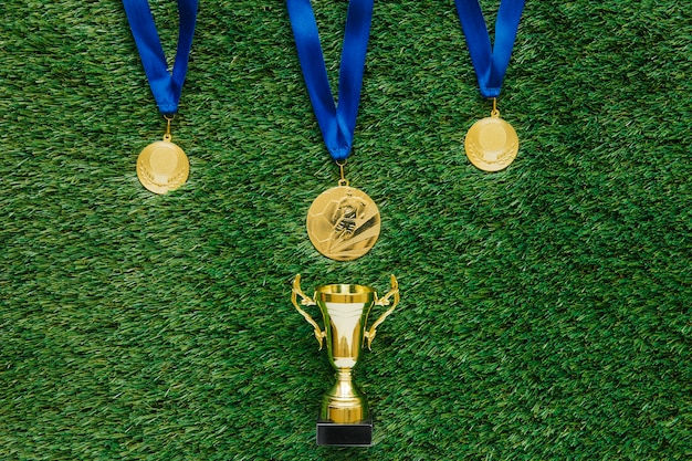 Football background with medals and trophy