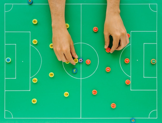 Football background with tactics concept and hands