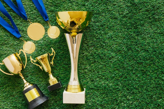 Football background with trophies and copyspace
