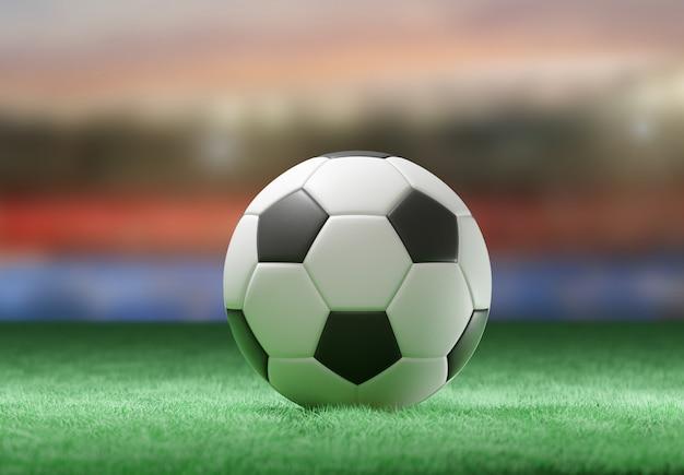 Football ball on the field of a stadium