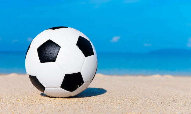 Football on the beach.