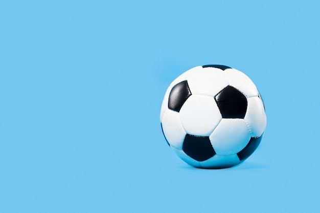 Football on blue background Premium Photo