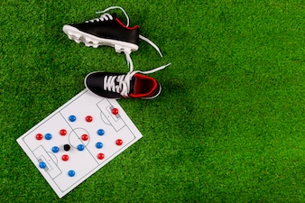 Football composition with board and shoes