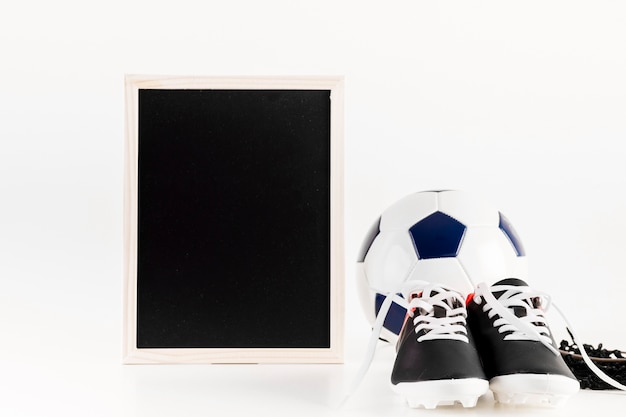 Football composition with leaning slate and shoes