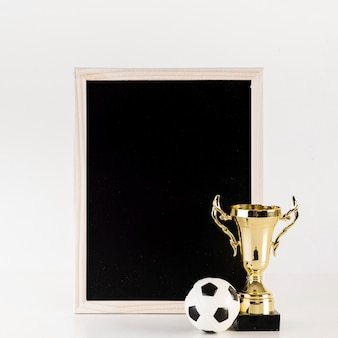 Football composition with leaning slate and trophy