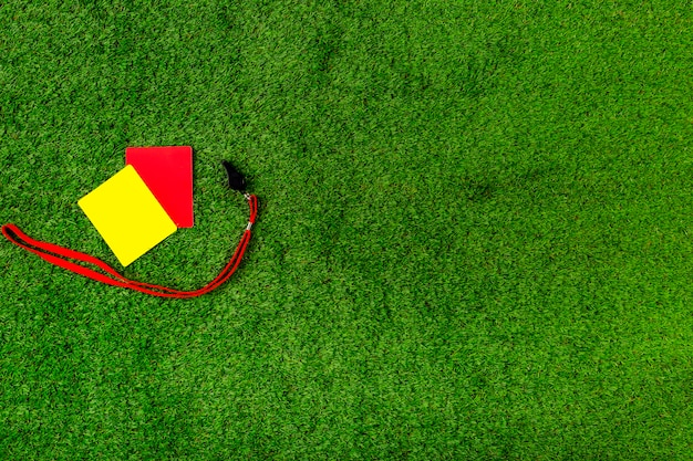 Football composition with red and yellow cards