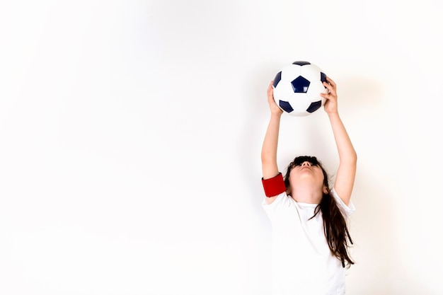 Football concept with girl and copyspace