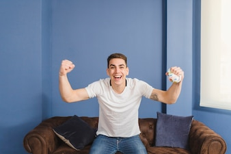 Football fan celebrating on couch