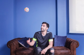 Football fan on couch