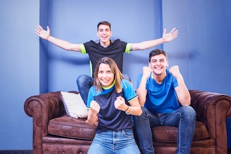 Football fans celebrating on couch