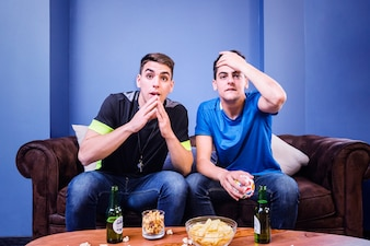 Football fans on couch can not believe it