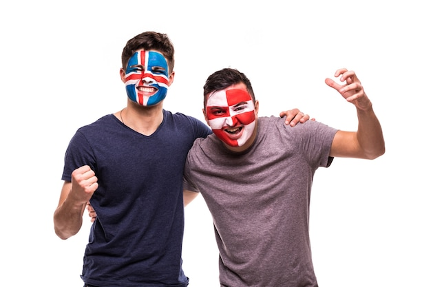 Football fans supporters with painted face of national teams of iceland and croatia isolated