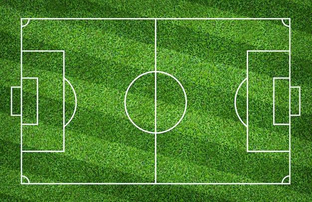 Футбольное поле или футбольное поле для предпосылки. зеленый газон для создания игры.
