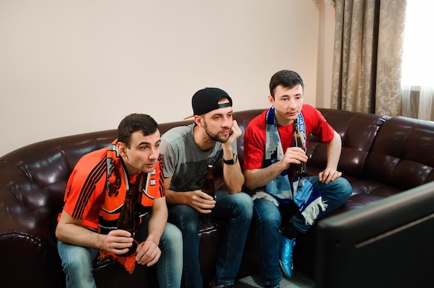 Football friends fans watching football, soccer at home