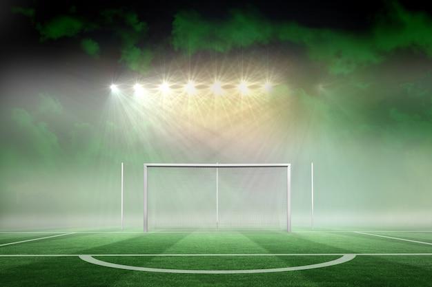 Football pitch under spotlights