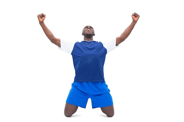 Football player in blue celebrating a win