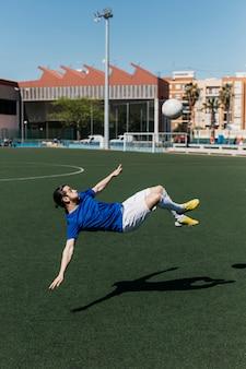 Football player doing bicycle kick
