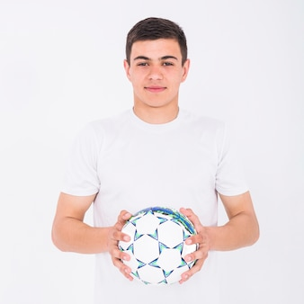 Football player holding ball
