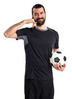 Football player making phone gesture