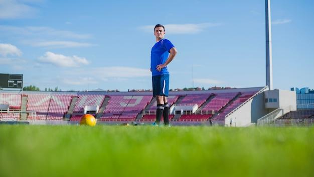 Football player in stadium preparing for free kick