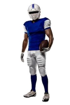 흰 벽에 파란색 유니폼과 축구 선수