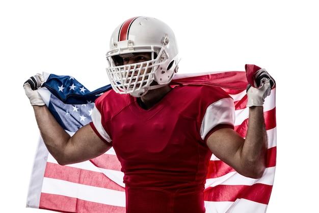 赤い制服と白のアメリカの国旗のフットボール選手