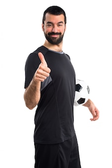 Football player with thumb up
