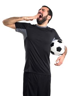 Giocatore di football americano sbadigliare
