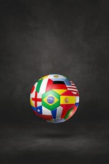 Футбольный мяч с национальными флагами, изолированные на черном фоне студии. 3d иллюстрации