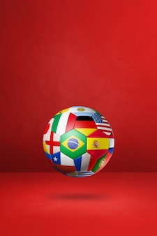 Футбольный футбольный мяч с национальными флагами, изолированных на красном фоне студии.