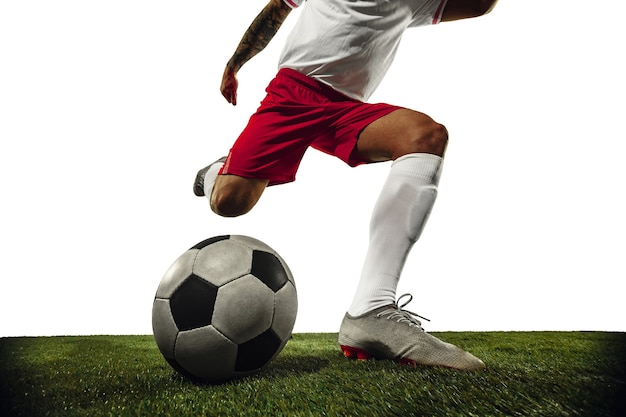 Football or soccer player on white background  motion action activity concept