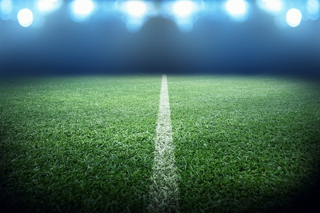 Football stadium, shiny lights, view from field. soccer concept Premium Photo