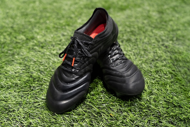 Football stud shoes on artificial grass field