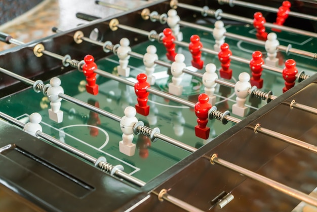 Football table game with red and white player .