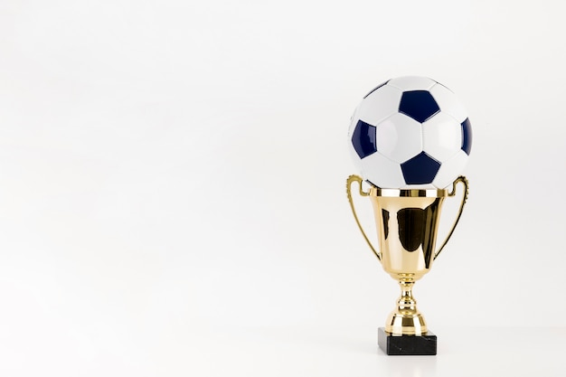 Football in trophy and copyspace