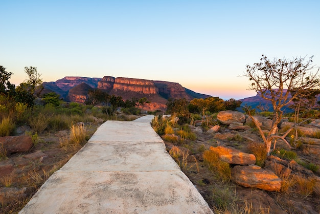 Footpath with sunset light on the mountain ridges