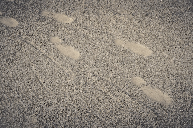 Footprint on sand beach background