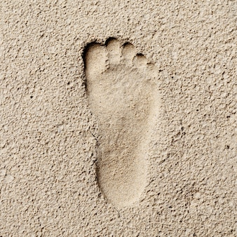 Footprint in sand, hi contrast style, stoneage