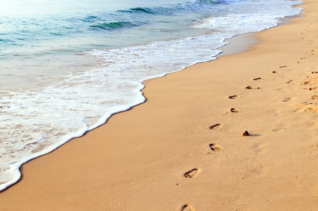 Footprints on the beautiful sand beach