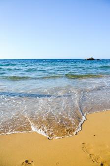 Footprints in the sand. beach in malia (greece, crete)