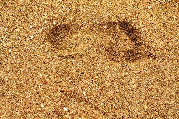 Footstep on the sand on the beach.