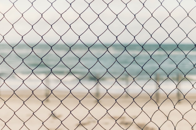 In the foreground is the grid, in the background the sea