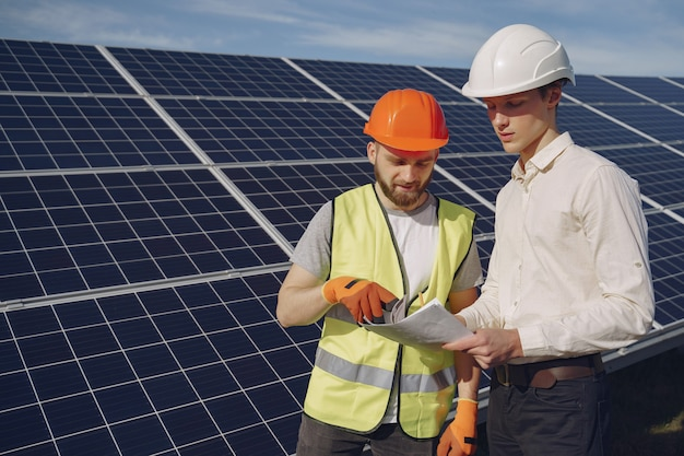 Foreman and businessman at solar energy station.