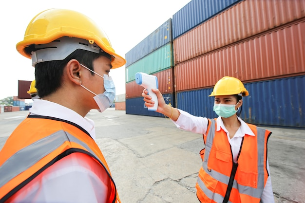 Foreman control loading containers box from cargo freight ship for import export. container warehouse worker.