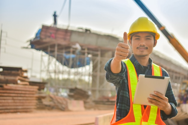 Foreman holding tablet use technology inspection control construction architecture site