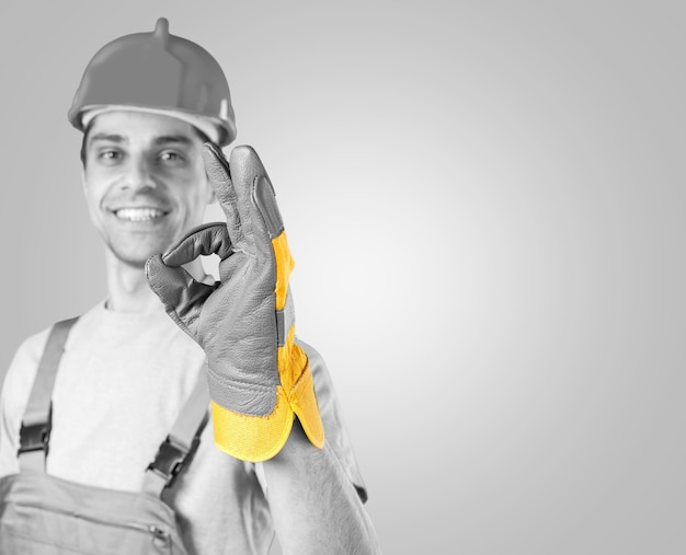 Foreman with  helmet with ok sign  isolated